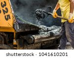 asphalt laying by workers | Shutterstock . vector #1041610201