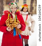 Happy girls with  round cracknel during  Shrovetide in Russia - stock photo