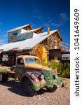 Small photo of USA. NEVADA. NELSON. SEARCHLIGHT. MARCH 2018: Eldorado Canyon Mine Tours. Many Old cars. Cinematographic place. Abandoned village.
