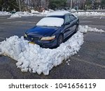 Small photo of RIDGEWOOD, NEW JERSEY/USA - MARCH 8, 2018: A late model Honda Accord in a New Jersey parking lot demonstrating what happens when you leave your car overnight in a public parking lot.