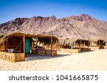 simple bungalow style shacks at ... | Shutterstock . vector #1041665875