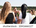 young people having picnic near ... | Shutterstock . vector #1041666127