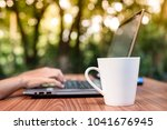 fresh morning coffee while... | Shutterstock . vector #1041676945