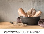 male baker prepares bread. male ... | Shutterstock . vector #1041683464