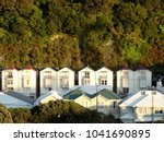 Small photo of Row of charming old colonial houses in evening sun at foot of steep Tinakori hill, Wellington. This type of architecture adds to the unique charm of the capital city of New Zealand.