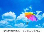 umbrella on blue sky | Shutterstock . vector #1041704767