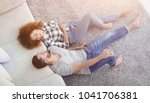 smiling couple lying on a... | Shutterstock . vector #1041706381