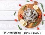 fresh shrimps or prawns raw on... | Shutterstock . vector #1041716077