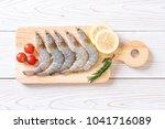 fresh shrimps or prawns raw on... | Shutterstock . vector #1041716089
