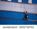 unidentify rope access repairer ... | Shutterstock . vector #1041716701