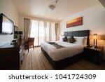 modern bedroom interior   big... | Shutterstock . vector #1041724309