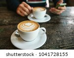 two cups of coffee on a wooden... | Shutterstock . vector #1041728155
