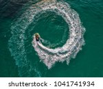 people are playing jet ski at... | Shutterstock . vector #1041741934