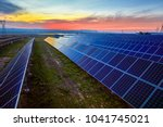 sunset under the solar... | Shutterstock . vector #1041745021