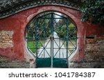 green gate set in a circular... | Shutterstock . vector #1041784387