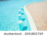 beautiful swimming pool at the... | Shutterstock . vector #1041801769