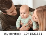 young parents with baby at home | Shutterstock . vector #1041821881