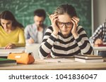 students solving problem quiz... | Shutterstock . vector #1041836047