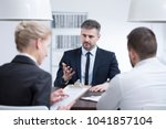 man in a suit talking about his ... | Shutterstock . vector #1041857104