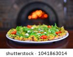 pizza in front of a stone stove ... | Shutterstock . vector #1041863014