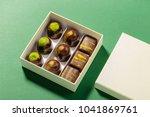 assortment of luxury bonbons in ... | Shutterstock . vector #1041869761