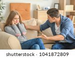 Small photo of Young couple in quarrel at home
