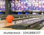 bowling ball rolls in between... | Shutterstock . vector #1041888157