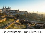 man looking at the sunrise over ... | Shutterstock . vector #1041889711