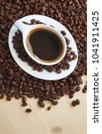 a cup of coffee  background   Shutterstock . vector #1041911425