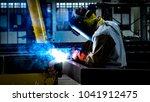 welding with sparks by process... | Shutterstock . vector #1041912475