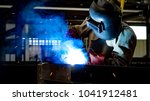 welding with sparks by process... | Shutterstock . vector #1041912481