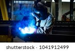 welding with sparks by process... | Shutterstock . vector #1041912499