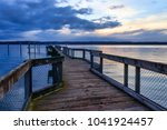 light and clouds over a wooden... | Shutterstock . vector #1041924457