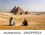 girls in the pyramids of giza ... | Shutterstock . vector #1041959314