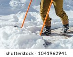 a man cleans the snow with a... | Shutterstock . vector #1041962941