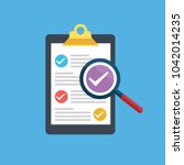 vector clipboard with checklist.... | Shutterstock .eps vector #1042014235