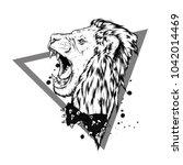 a beautiful roaring lion.... | Shutterstock .eps vector #1042014469
