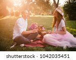 young beautiful couple drinking ...   Shutterstock . vector #1042035451
