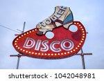 "retro neon ""roller disco"" sign | Shutterstock . vector #1042048981"