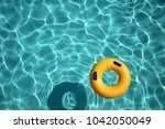 yellow pool ring floating in a... | Shutterstock . vector #1042050049