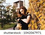 beautiful long haired girl... | Shutterstock . vector #1042067971