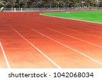 red running track  white line... | Shutterstock . vector #1042068034