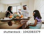 arabic happy family lifestyle... | Shutterstock . vector #1042083379