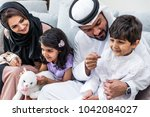 arabic happy family lifestyle... | Shutterstock . vector #1042084027