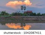 thai house in garden on sunset... | Shutterstock . vector #1042087411