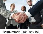 welcome and handshake business... | Shutterstock . vector #1042092151