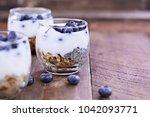 kefir yogurt and chia parfaits. ...   Shutterstock . vector #1042093771