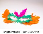 carnival mask with feathers | Shutterstock . vector #1042102945