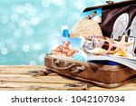 suitcase and summer tools on... | Shutterstock . vector #1042107034