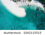 the white fine sand with clear... | Shutterstock . vector #1042115515
